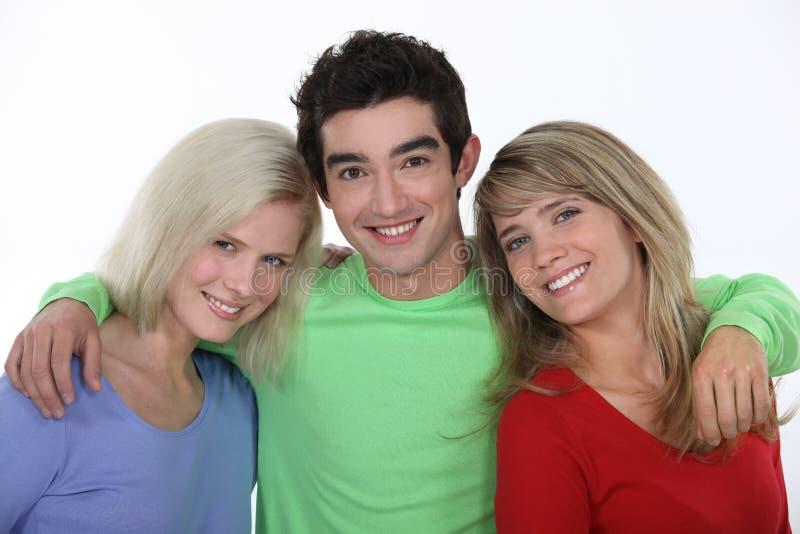 Drie dichte vrienden stock foto's