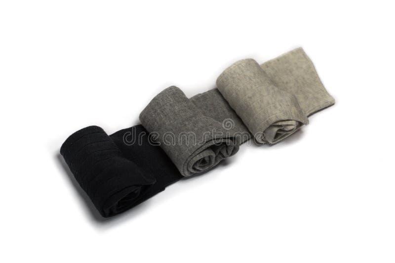 Drie die paar sokken op een witte achtergrond wordt geïsoleerd stock afbeeldingen