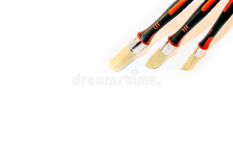 Drie die penselen op een witte achtergrond worden geïsoleerd royalty-vrije stock foto