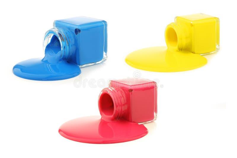 Drie flessen met de primaire kleuren stock foto