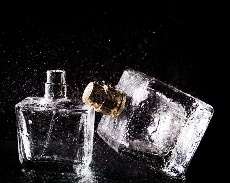Drie flessen parfums stock foto