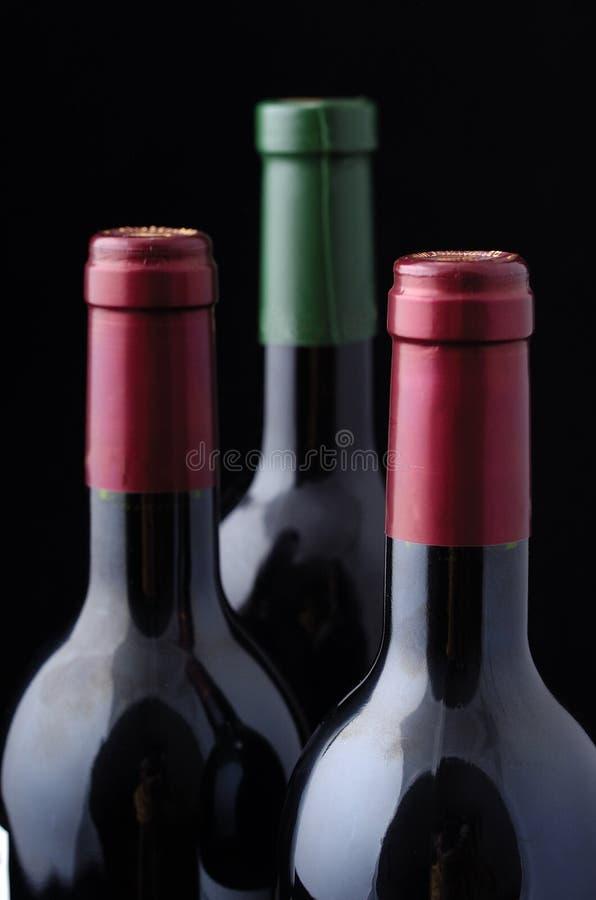 Drie flessen van de Wijn royalty-vrije stock afbeelding