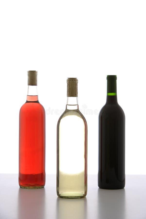 Drie Flessen van de Wijn stock afbeelding