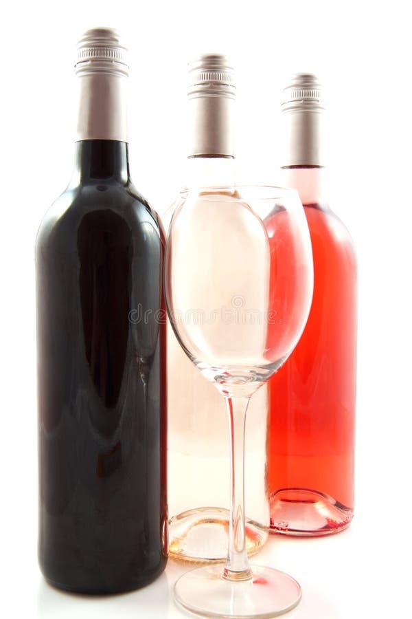 Drie flessen wijn royalty-vrije stock fotografie