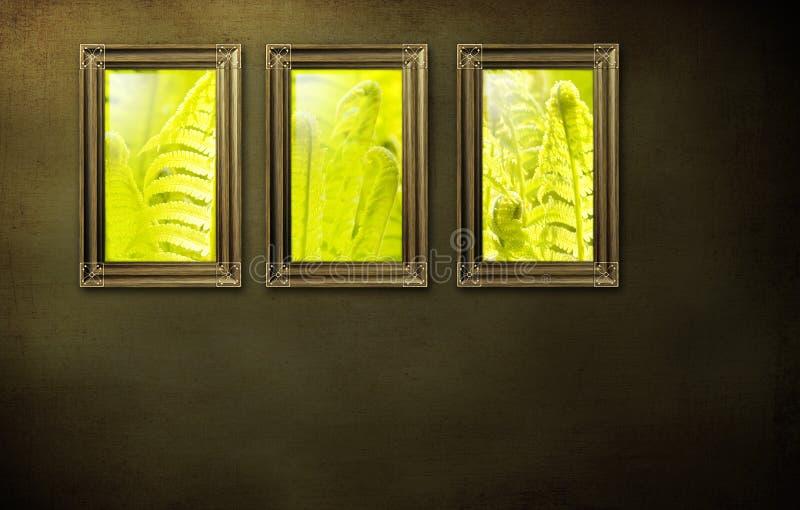 Drie frames op muur royalty-vrije stock afbeeldingen