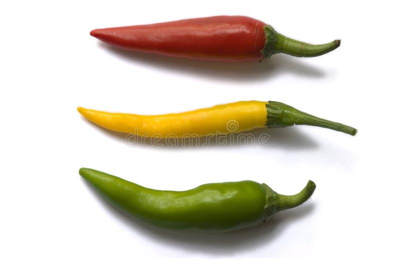 Drie gekleurde peper stock afbeelding