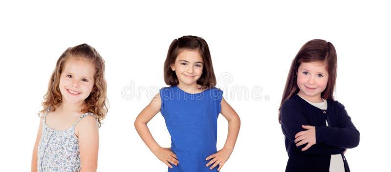Drie gelukkig kinderenmeisje royalty-vrije stock foto