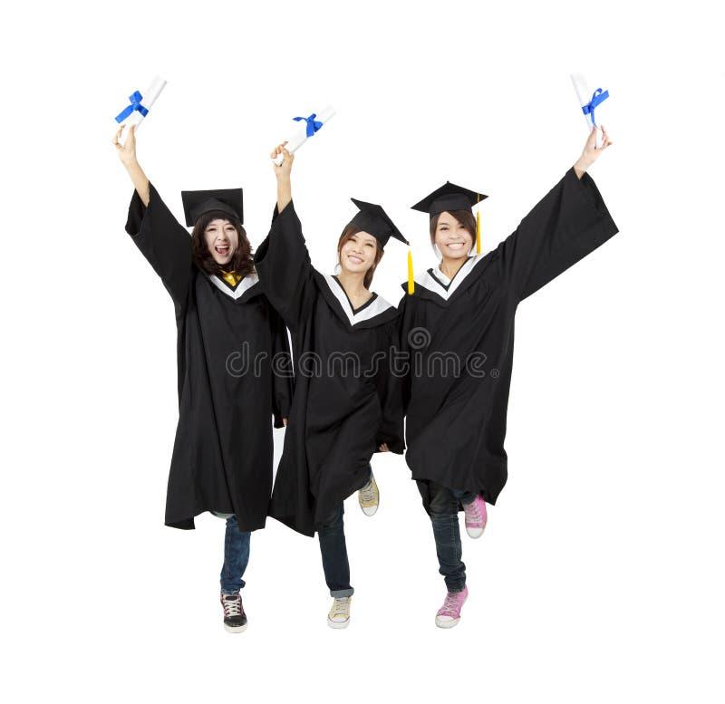 Drie gelukkige Aziatische graduatiestudent stock fotografie