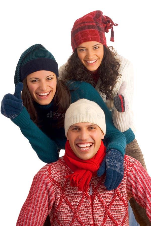 Drie gelukkige de wintervrienden stock afbeelding