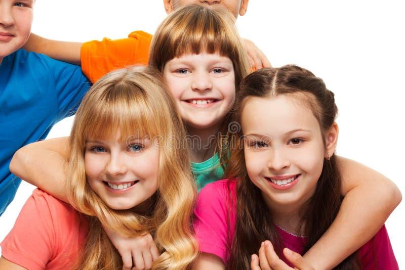 Drie gelukkige glimlachende meisjes royalty-vrije stock foto