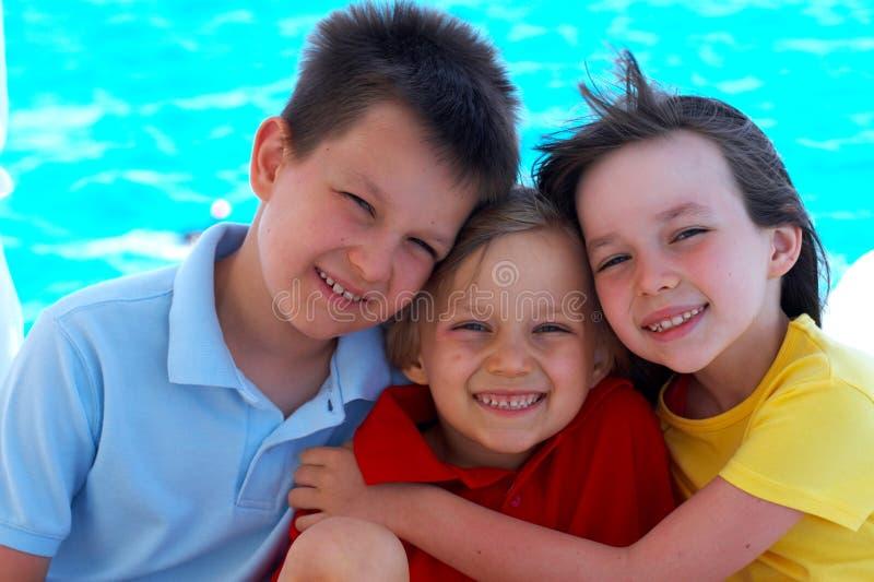 Drie gelukkige jonge geitjes royalty-vrije stock afbeelding
