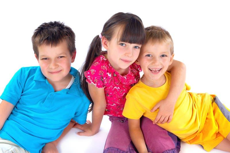 Drie gelukkige jonge geitjes royalty-vrije stock afbeeldingen