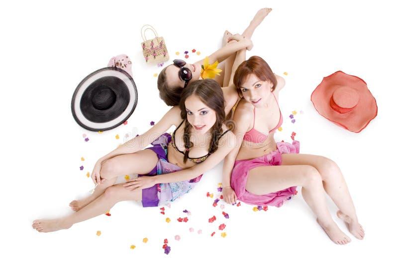 Drie gelukkige jonge meisjes royalty-vrije stock afbeeldingen