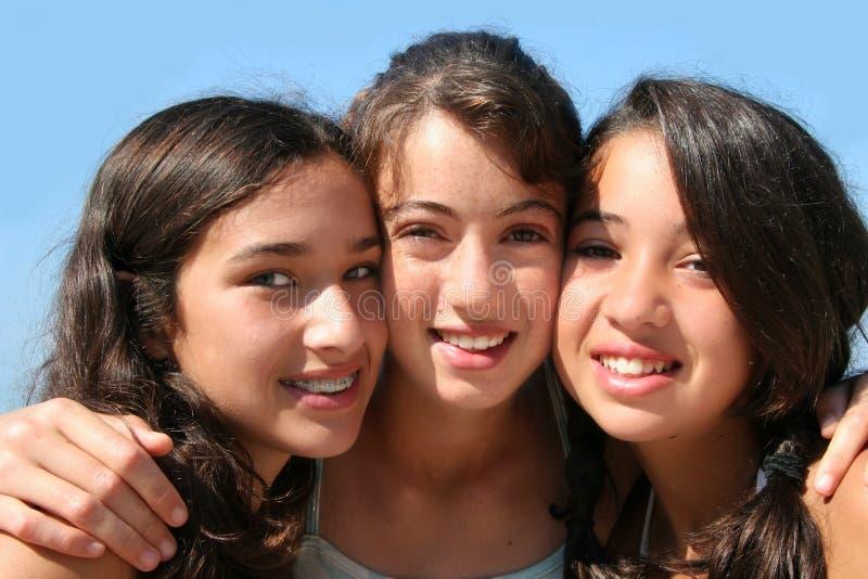 Drie gelukkige meisjes royalty-vrije stock afbeelding