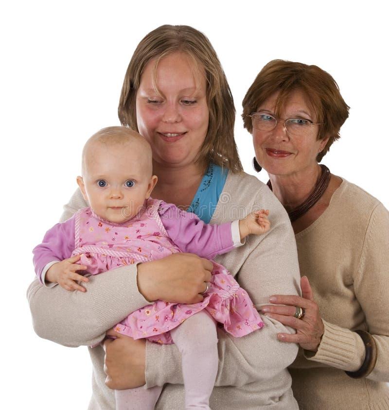 Drie generaties 7 op wit stock afbeelding