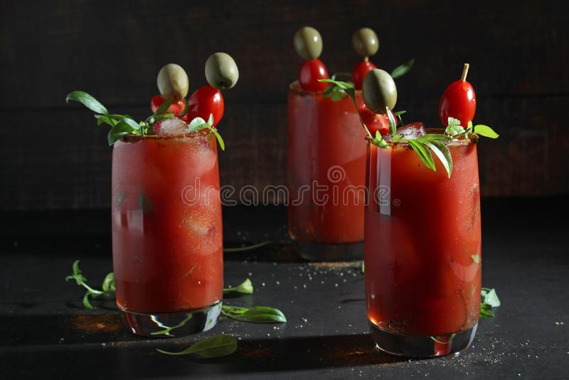 Drie glazen met Bloody Marycocktail stock afbeelding