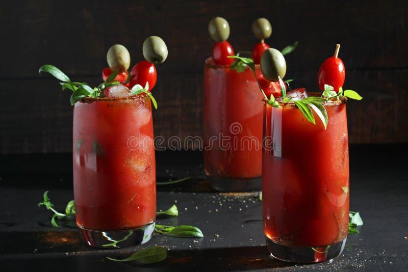 Drie glazen met Bloody Marycocktail stock fotografie