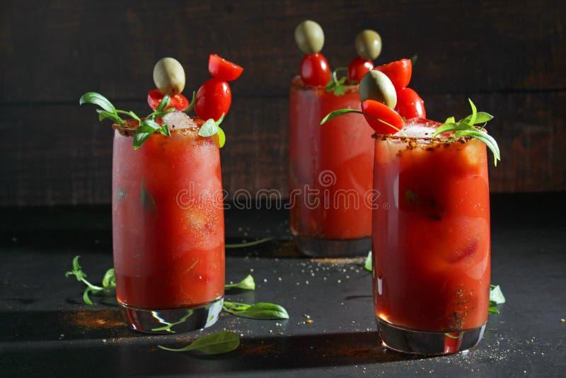 Drie glazen met Bloody Marycocktail stock foto's