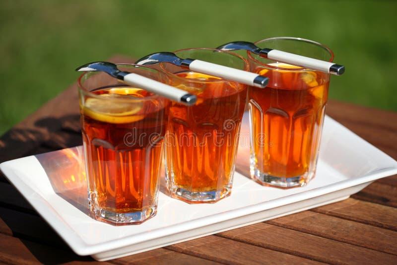 Drie glazen thee stock foto