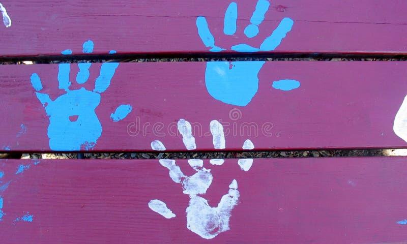 Drie Handen, Blauw en Wit royalty-vrije stock foto