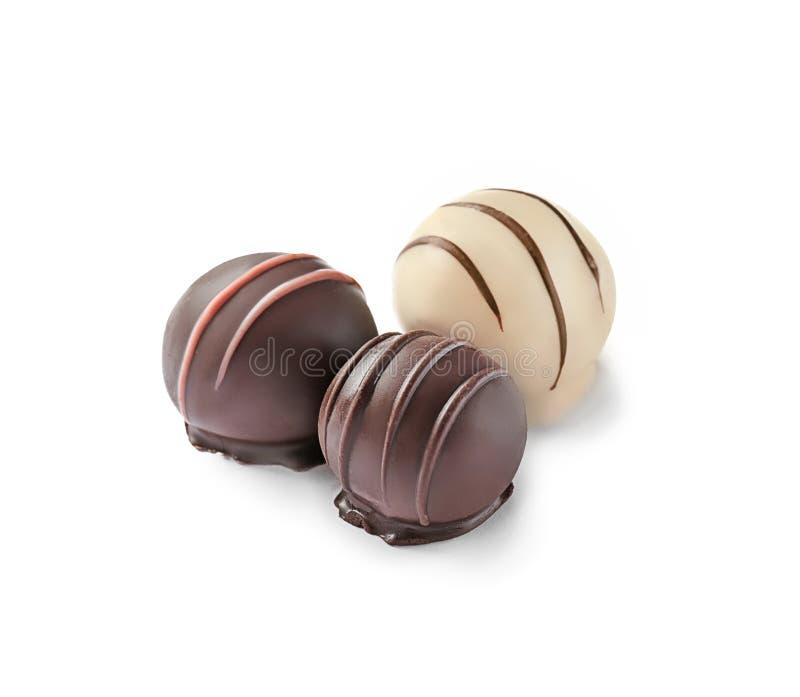 Drie heerlijk chocoladesuikergoed royalty-vrije stock foto's