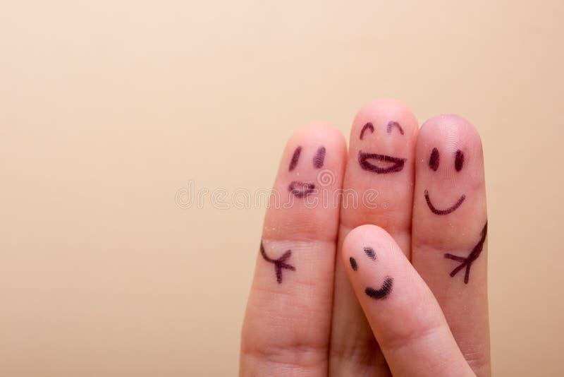 Drie het glimlachen vingers die zeer gelukkig vrienden zijn te zijn royalty-vrije stock foto's