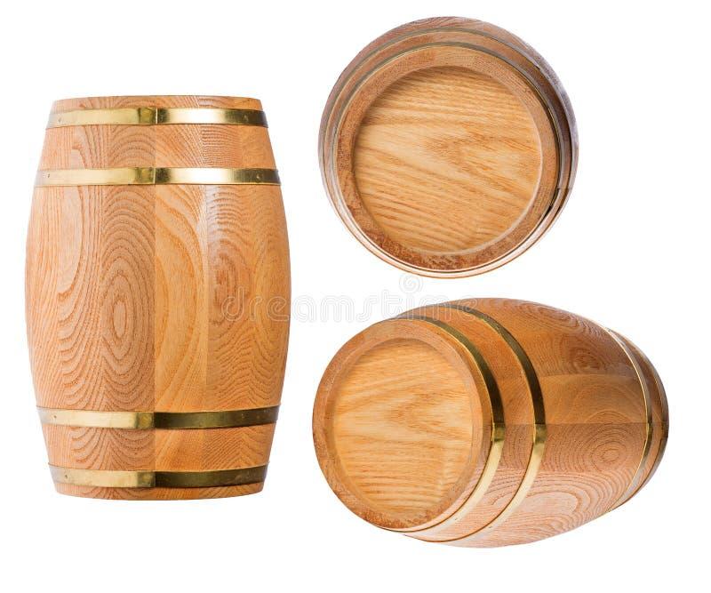 Drie houten die vaten op wit worden geïsoleerd stock foto's
