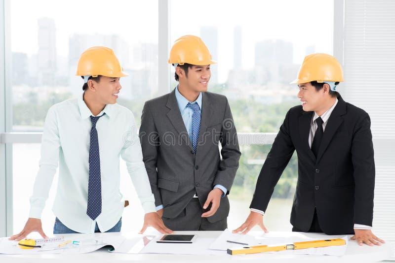 Drie ingenieurs royalty-vrije stock afbeeldingen