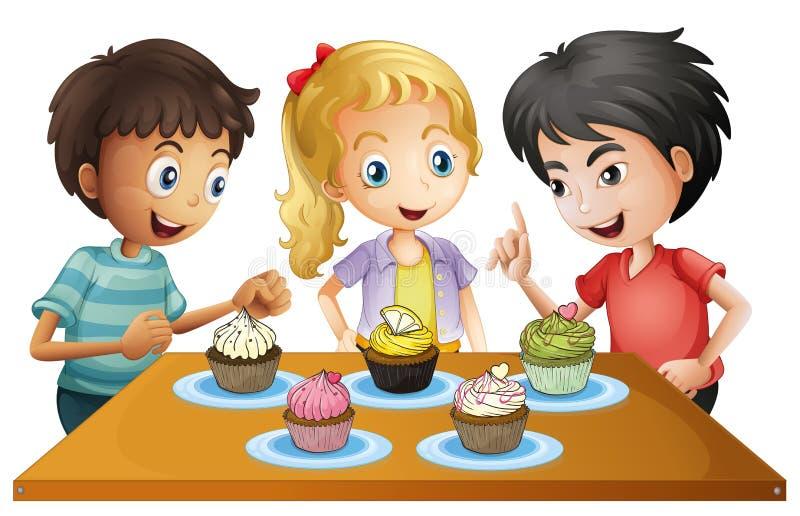 Drie jonge geitjes bij de lijst met cupcakes royalty-vrije illustratie