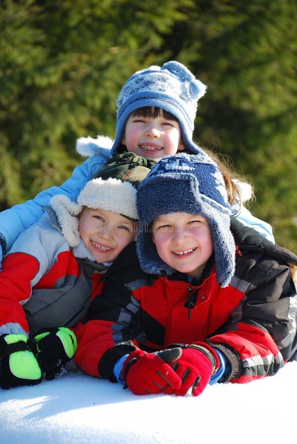 Drie Jonge geitjes in de Sneeuw royalty-vrije stock afbeeldingen