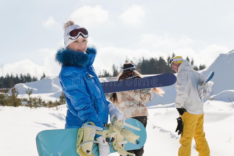 Drie jonge snowboarders royalty-vrije stock foto
