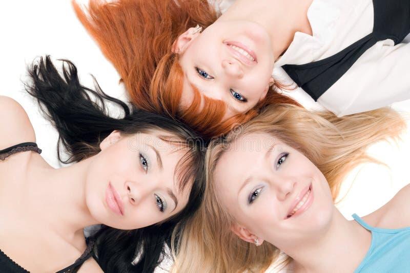 Drie jonge vrolijke vrouwen royalty-vrije stock foto's
