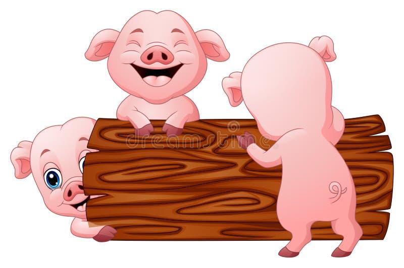 Drie klein varkensbeeldverhaal in het logboek royalty-vrije illustratie
