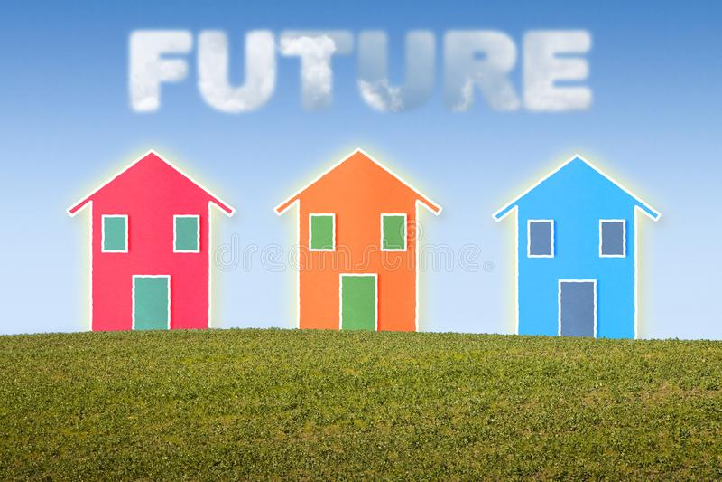 Drie kleine gekleurde die huizen met Toekomst op blauwe hemel wordt geschreven stock illustratie
