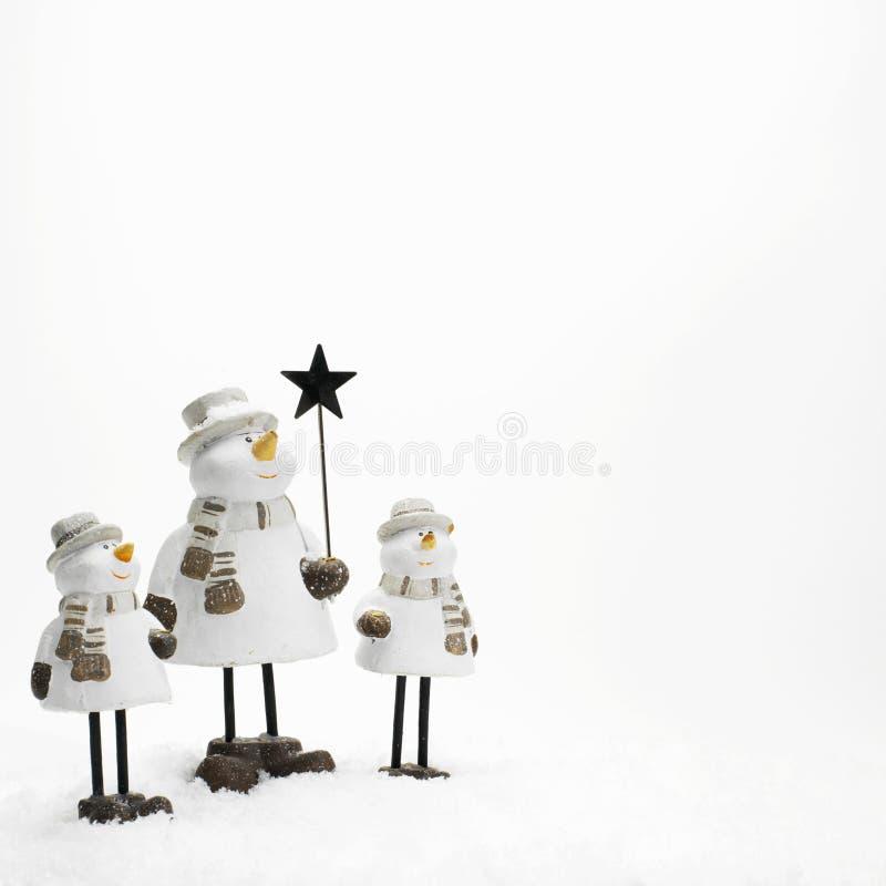 Drie kleine sneeuwmannen royalty-vrije stock afbeeldingen