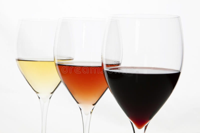 Drie kleuren van wijn. Het rood, nam en wit toe. stock foto's