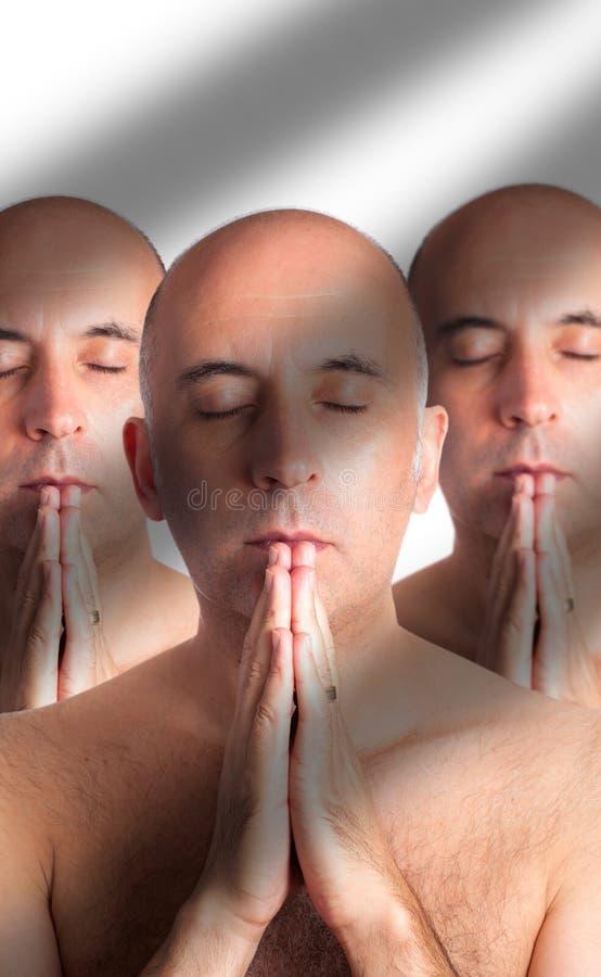 Drie klonen of drietallen het mediteren stock afbeelding
