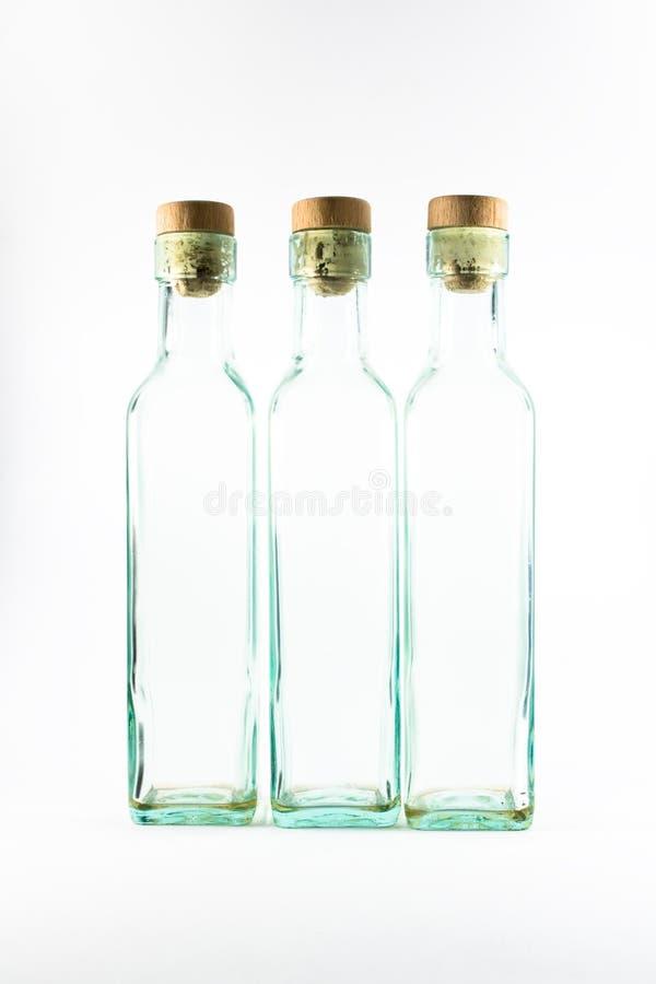 Drie lege flessen isoladed royalty-vrije stock foto