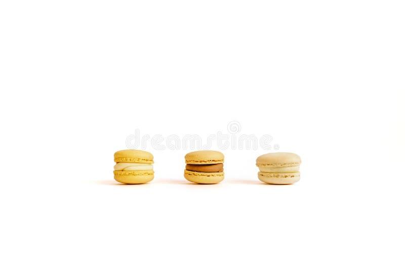 Drie makarons op een witte achtergrond stock afbeelding