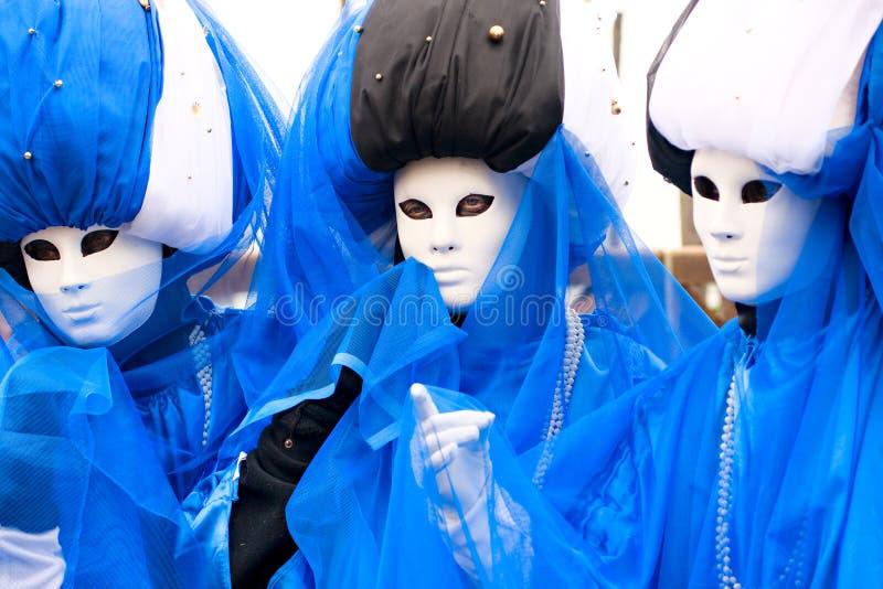 Drie maskers in Venetië stock fotografie