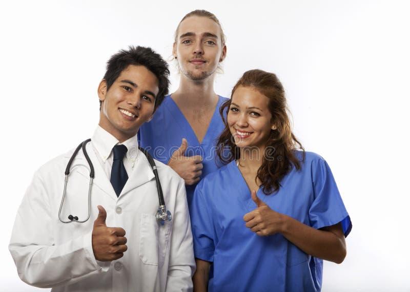 Drie medische studenten/internen/nurdses stock fotografie
