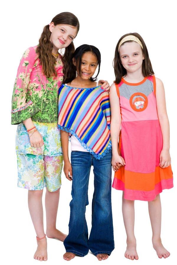 Drie Meisjes die samen glimlachen stock foto's