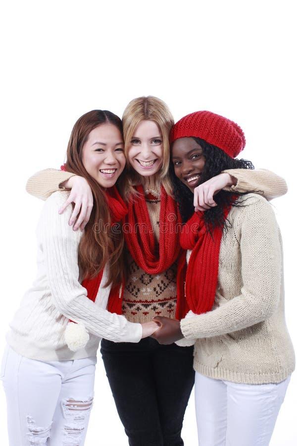 Drie meisjes met verschillende afleiding royalty-vrije stock afbeelding
