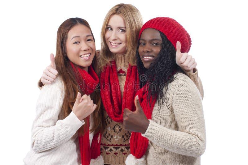 Drie meisjes met verschillende geïsoleerde afleiding stock foto's