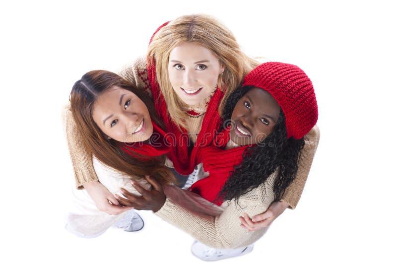 Drie meisjes met verschillende hierboven afleiding van stock foto