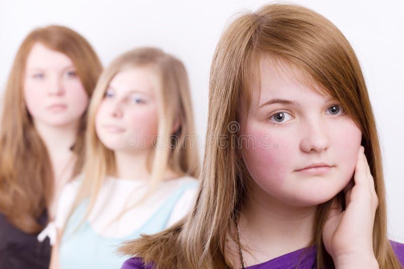 Drie meisjestieners in crisis stock foto's
