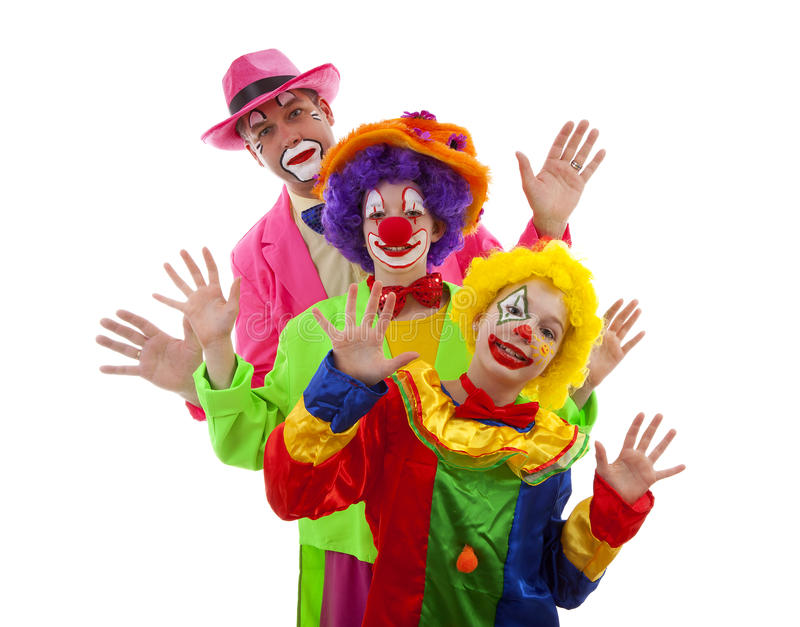 Drie mensen kleedden zich omhoog als kleurrijke grappige clowns royalty-vrije stock afbeeldingen