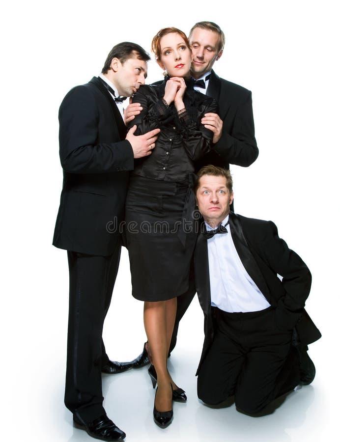 Drie mensen in smokingen en vrolijk meisje royalty-vrije stock afbeeldingen
