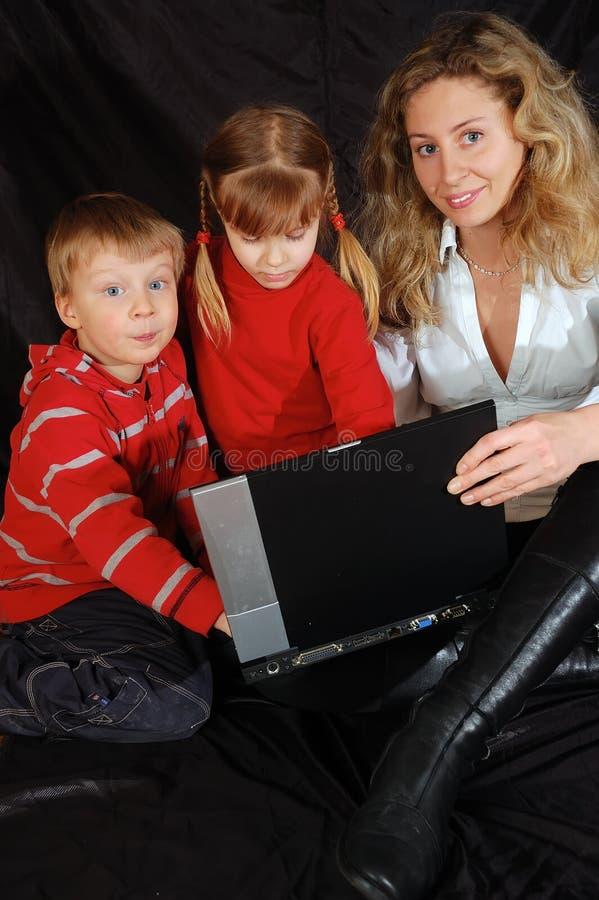 Drie met laptop
