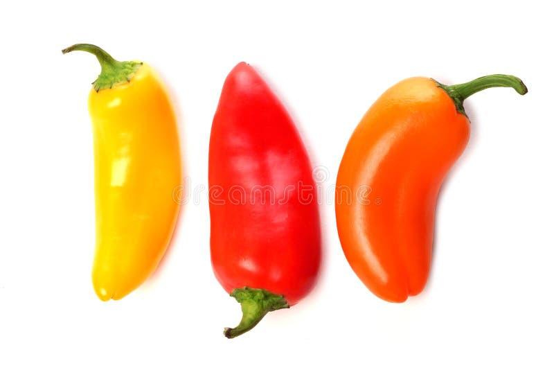 Drie minidie paprika's op een witte achtergrond worden geïsoleerd royalty-vrije stock foto